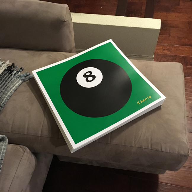 8 ball print stack on couch max eberle art